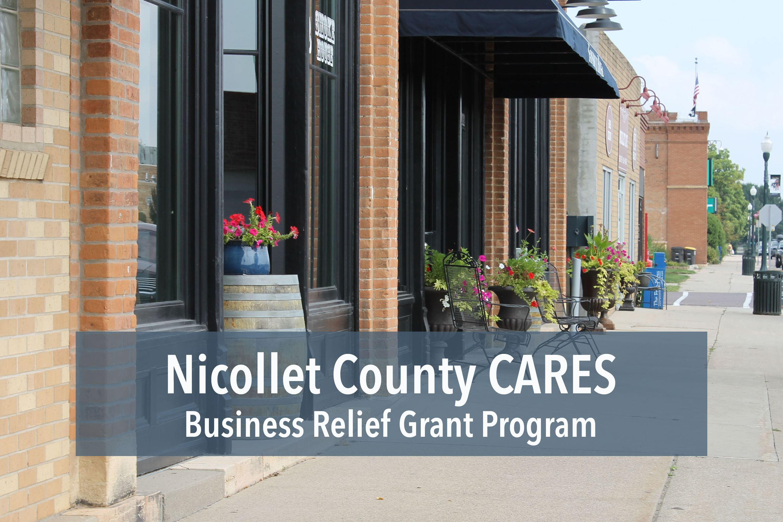 Storefront with text reading Nicollet County CARES Business Relief Grant Program